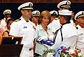 US Navy 061210-N-5621B-093 USS Frank Cable (AS 40) Commanding Officer Capt. Leo Goff prepares to accept an American flag on behalf of the family of Machinery Repairman Fireman Jack Valentine during a memorial service held in th.jpg