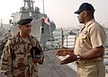 US Navy 070226-N-8560S-005 USS Anzio (CG 68) Command Master Chief William Seegars talks to Iraqi navy Chief Warrant Officer 2nd Class Abdul Majeed during a tour of the ship.jpg