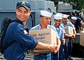 US Navy 070531-N-0120A-007 Ensign John J. Burke, assigned to dock landing ship USS Harpers Ferry (LSD 49), helps Philippine navy sailors load food and supplies onto a truck for delivery to an orphanage.jpg