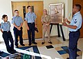 US Navy 070721-N-7427G-003 Air Traffic Controller 1st Class Terrell Moore explains the history of Callendar Field to Sea Cadets from the greater New Orleans region.jpg