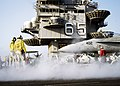 US Navy 071005-N-5681S-069 Flight deck personnel prepare to launch an F-A-18C Hornet attached to the Sidewinders of Strike Fighter Squadron (VFA) 86, from the flight deck of the nuclear-powered aircraft carrier USS Enterprise (.jpg