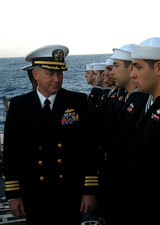 "Uniforms of the United States Navy - A navy officer wearing Service Dress Blues, inspects enlisted sailors in their service dress blue ""crackerjacks"" in February 2008."