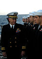 US Navy 080218-N-5476H-007 Cmdr. Richard Martel, executive officer of the guided-missile cruiser USS Lake Erie (CG 70), inspects the dress blue uniforms of Sailors during a uniform inspection on the flight deck prior to a buria.jpg