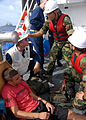 US Navy 080805-N-9758L-109 Hospital Corpsman 3rd Class Michael Mullin and Korean sailors discuss possible treatments for Coast Guard Fireman Logan Schindlerduring.jpg