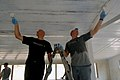 US Navy 090304-N-1688B-311 Aviation Boatswain's Mate (Handling) Airman Michael McCann and Storekeeper 2nd Class Dale Newman, both assigned to the amphibious transport dock ship USS Nashville (LPD 13), repaint the ceiling of a t.jpg