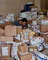 US Navy 090625-F-7885G-061 Postal Clerk 3rd Class Mark Gonzalez, assigned to the Military Sealift Command hospital ship USNS Comfort (T-AH 20), sorts mail during a port visit.jpg
