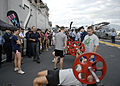 US Navy 090701-N-9520G-008 ailors aboard the amphibious assault ship USS Essex (LHD 2) prepare to participate in a timed weight lifting competition during a live broadcast of the.jpg