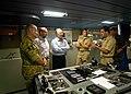US Navy 090720-N-9689V-013 Capt. Jonathan Olmstead, ship's master of the Military Sealift Command dry cargo-ammunition ship USNS Richard E. Byrd (T-AKE 4), explains aspects of the ship's bridge to Australian High Commissioner t.jpg