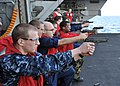 US Navy 110214-N-0569K-040 Sailors aboard the aircraft carrier USS Enterprise (CVN 65) participate in 9 mm pistol qualifications.jpg