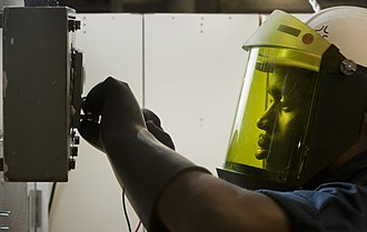 Face shield - Image: US Navy 110301 N DR144 037 Electrician's Mate Fireman Alex Kline, assigned to the electrical division of the engineering department of the Nimitz c