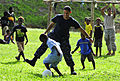 US Navy 110430-N-KB563-145 A Sailor plays soccer with local children during a community service project at Unity Park.jpg