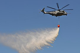 US Navy 110512-N-5226D-277 A CH-46E Sea Knight helicopter assigned to Marine Medium Helicopter Squadron (HMM) 364 drops water during an annual fire.jpg