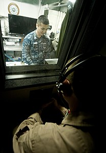 US Navy 120112-N-OY799-052 Hospital Corpsman 2nd Class Charlie Nguyen, from Fountain Valley, Calif., performs an audiogram aboard the Nimitz-class.jpg
