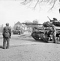US paratroopers ride Churchill tanks Dorsten Germany March 1945 IWM BU 2740.jpg