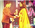 Utthara Unni Receiving Award.png