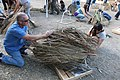Ventura Fish and Wildlife Office Field Supervisor Steve Henry helps attach palm fronds to base (22856272877).jpg