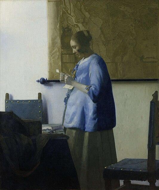 手紙を読む青衣の女