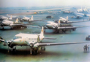 Tan Son Nhut Air Base - VNAF C-47s of the 413th Transportation Squadron on the crowded flightline at Tan Son Nhut along with an RAF De Havilland Dove and several other aircraft.