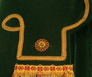 Soutache - A curved border of soutache trim in drapery found in the Senate Chamber of the Vermont State House.