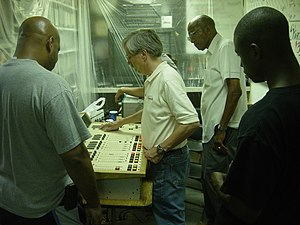 Prometheus Radio Project - Studying the console at the WMXP-LP Barnraising, June 2007.