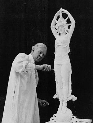 Alexander Stirling Calder - A. Stirling Calder at work on the Star Maiden (1913). Audrey Munson was the model.