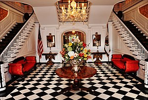 West Virginia Governor's Mansion - The foyer has checkered marble flooring and dual staircases.