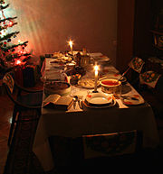 Ways to celebrate holidays may be passed down as traditions, as in this Polish Christmas meal and decorations