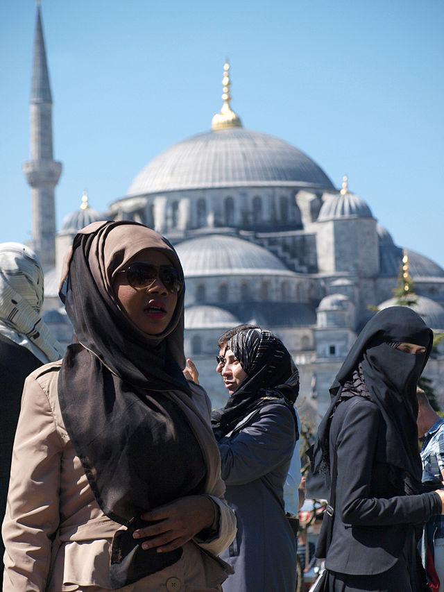 Muslim women near The Blue Mosque in Istanbul, Turkey