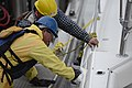 Workers wipe oil from the side of a vessel in Galveston, Texas, March 27, 2014 140327-G-BA104-002.jpg