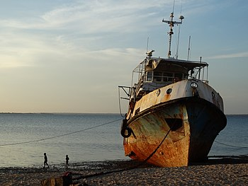 Wreck of a ship, stranded on the beach of Mozambique Island.jpg