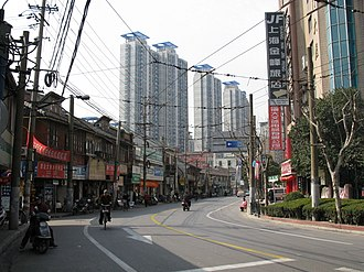Old City (Shanghai) - This scene at the Old City's southern boundary neatly summarises its position today: traditional houses of the Old City are on the left, newer developments across the former moat on the right, and encroaching highrises in the background.
