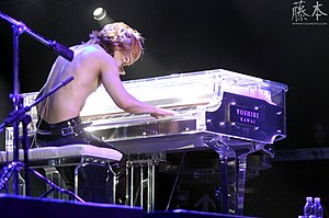 Yoshiki (musician) - Yoshiki playing the piano with X Japan at the concert in Brasil 2011, after the band's reunion in 2007.