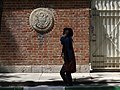 Young Woman Strolls Past Facade of Old US Embassy (US Den of Espionage) - Tehran - Iran (7383372934).jpg