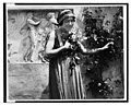 Young woman clutching flowers - The Last Days of Pompeii.jpg