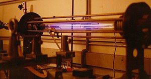 Z-pinch - Laboratory scale Z-pinch showing glow from an expanded hydrogen plasma. Pinch and ionisation current flows through the gas and returns via the bars surrounding the plasma vessel.