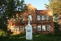Училище мужское 4-классное в с. Юрла с памятником.jpg