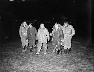 No. 102 Squadron RAF - 102 Squadron Whitley aircrew walk from their aircraft after dropping leaflets over Prague