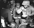 "111-SC-19650 - These hungry infantrymen of the 7th Army waste no time when they hear ""seconds on cake"". Bult area, France.jpg"