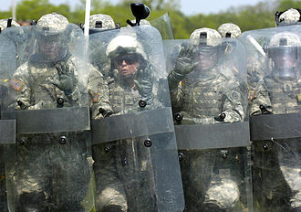 Riot shield - United States Army soldiers form a shield wall.