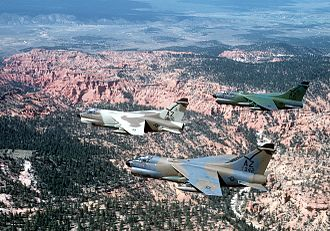 152d Fighter Squadron - A-7D Corsair II aircraft (s/n 70-1006, 70-1013, 71-0342) from the 152d Tactical Fighter Squadron, fly in formation over the desert near Tucson, Arizona on 19 September 1981. The aircraft, each in a different paint scheme, were being tested against desert and forest background for visibility.