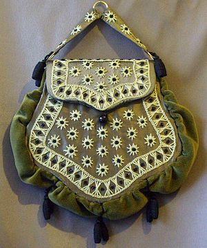 "Handbag - An 1875 Chatelaine bag, with a buckram frame and velvet body. It would have been ""hooked"" into the waist of the skirt."