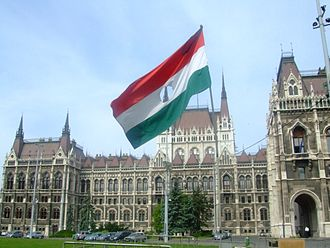 Flag desecration - 1956 Revolution Flag flying in front of the Hungarian Parliament Building