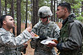 1st Lt. Kunal D. Desai, a fire support officer in the 82nd Airborne Division's 1st Brigade Combat Team talks to an officer from the Indian Army.jpg