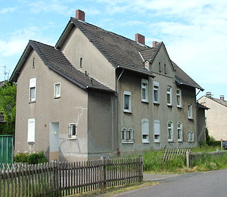 Environmental impact of mining - House in Gladbeck, Germany, with fissures caused by gravity erosion due to mining.