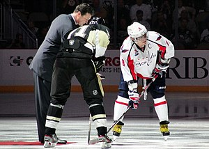 Evgeni Malkin - Mario Lemieux joined Malkin and Alexander Ovechkin for the ceremonial puck drop before 13 October 2011 game between the Penguins and Capitals, to honour the victims of the Lokomotiv Yaroslavl plane crash.