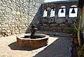 2019 Mission San Juan Capistrano Sacred Garden fountain and bell wall.jpg