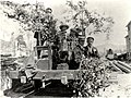 6 men dressed in their best suits on a Brownlee and Co. jigger decorated with folliage and native clematis (Brownlee Tramway, Marlborough Museum, Marlborough Historical Society).jpg