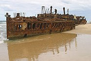 and the rusted remains of the ship in 2007