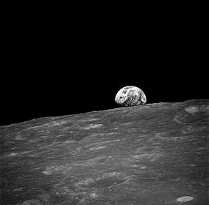 Lunar orbit - The Moon from lunar orbit, with planet Earth rising over the horizon, taken on the Apollo 8 mission on December 24, 1968.