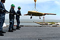 A U.S. Navy X-47B unmanned combat air system is loaded onto the flight deck of the aircraft carrier USS George H.W. Bush (CVN 77) in Norfolk, Va., May 6, 2013 130506-N-YZ751-222.jpg